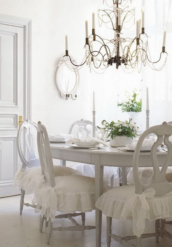 white shabby chic dining room with French shabby chic chairs with frilly white aprons