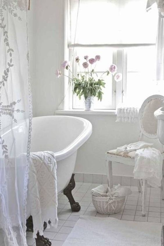 white shabby chic bathroom with vintage tub