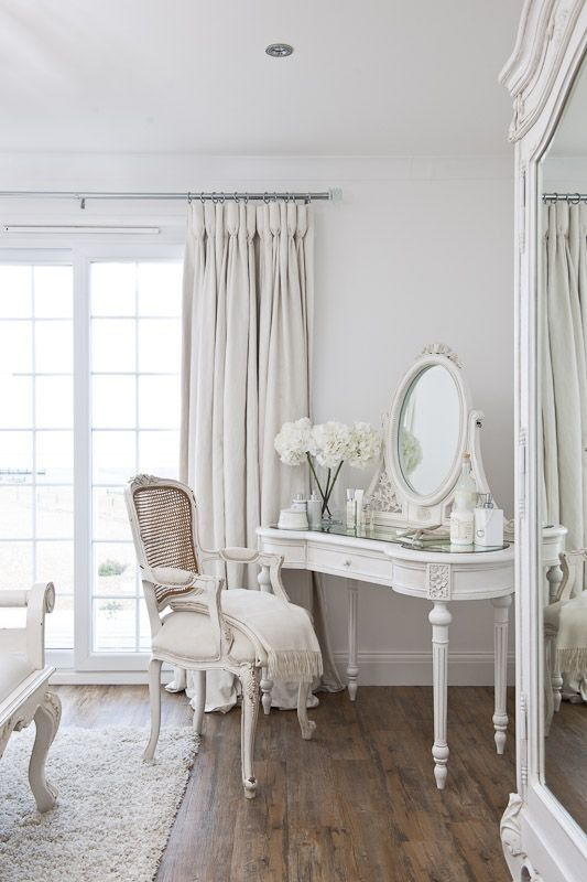 whit shabby chic bedroom with vanity table and chair