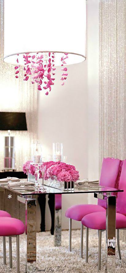 """Use a pop of color on a white palette, like these hot pink dining chairs and chrome table. Love the chandelier's pink """"crystals"""" and the drum shade, which is bright yet soft lighting.:"""