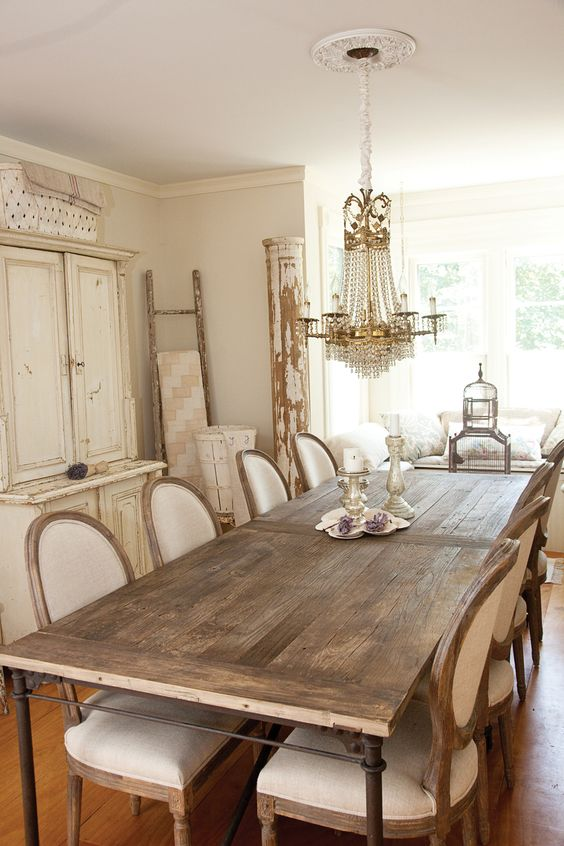 Vintage Cottage Chic Dining room with country french dining chairs.: