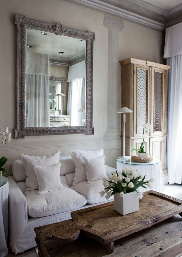 A distressed mirror adds rustic charm.