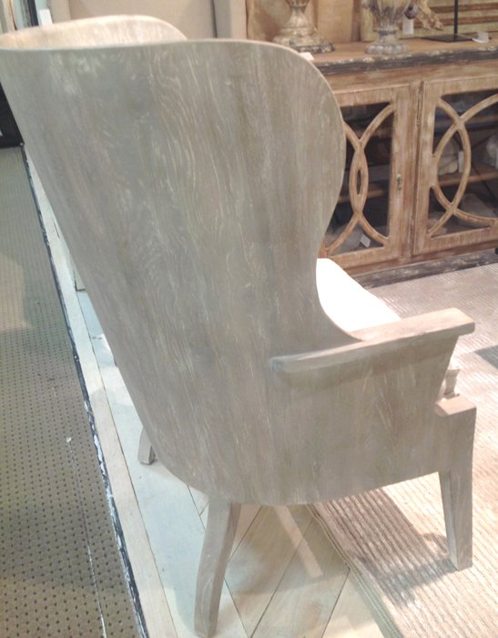 french wood carved chair with modern appeal