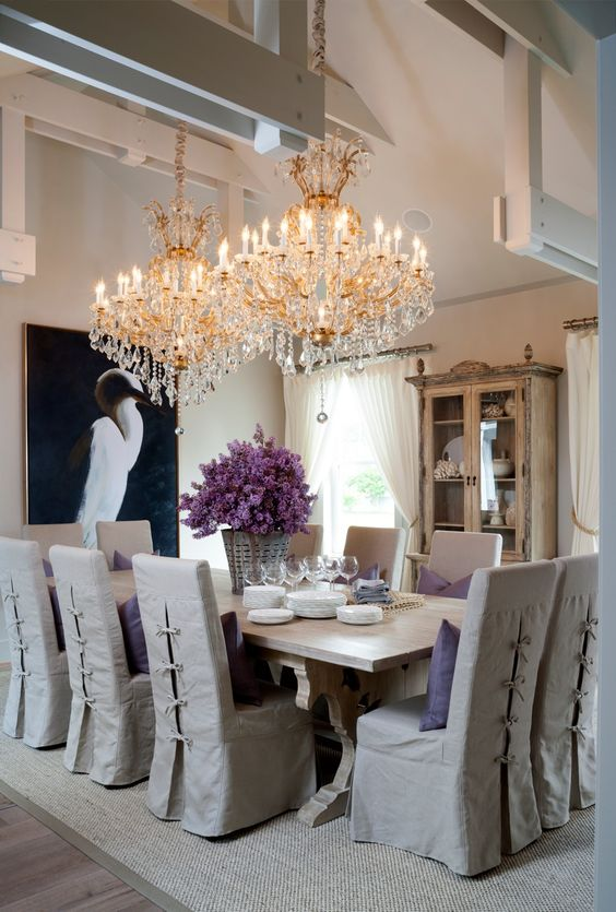 Dining room, beamed ceiling and crystal chandeliers.: