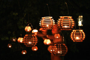 Firefly Luminairies. Wooden lantern kits for tealights. Light up your outdoor party!