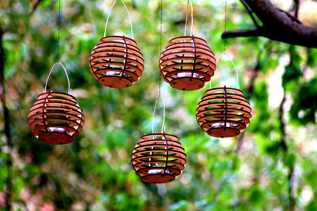 Firefly Luminairies. Wooden lantern kits for tealights. Light up your outdoor party! 1