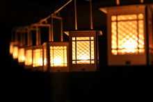 Load image into Gallery viewer, Craftsman Bungalow Luminaires. Lanterns give off warm light while hanging or on a table.