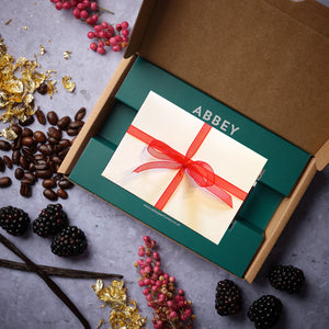 Luxe Discovery Box with a wrapped gift voucher