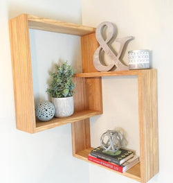 Linked Wall Shelf With Fake Plant, Ornaments and Books