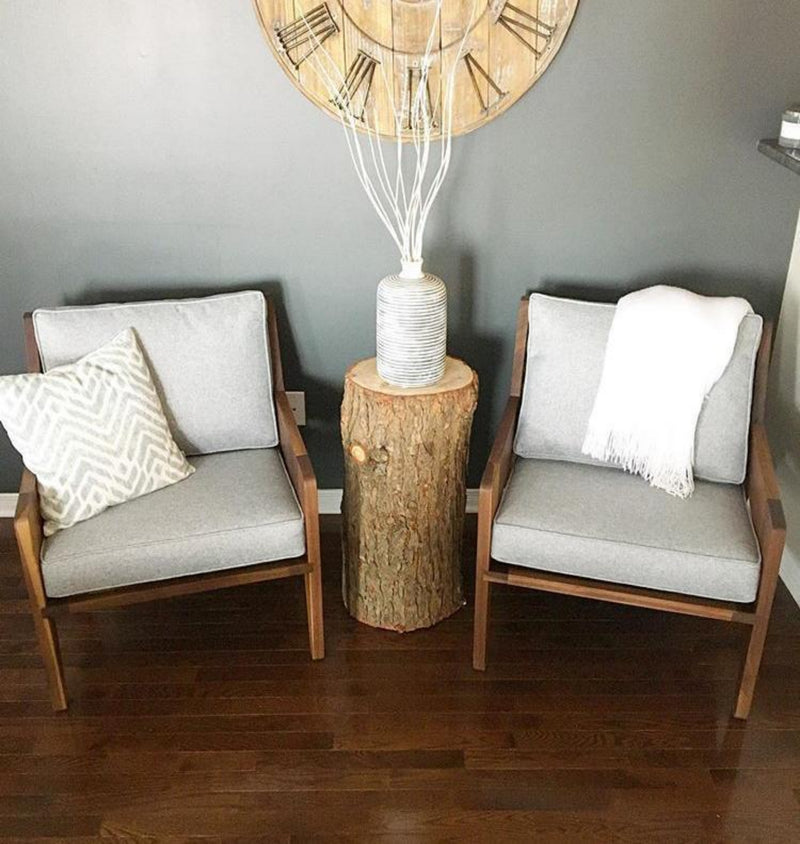 A Pair of Wellington Armchairs With a Tree-stump In Between Them