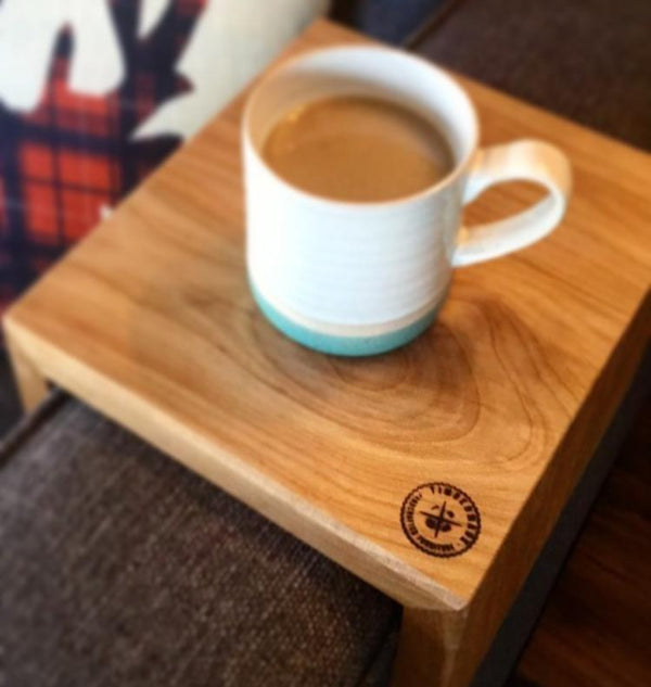 Wooden Couch Caddy On Armrest Of Couch With Coffee On It