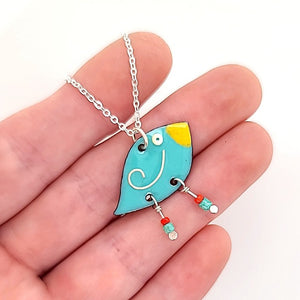 enameled bird pendant by Kathryn Riechert