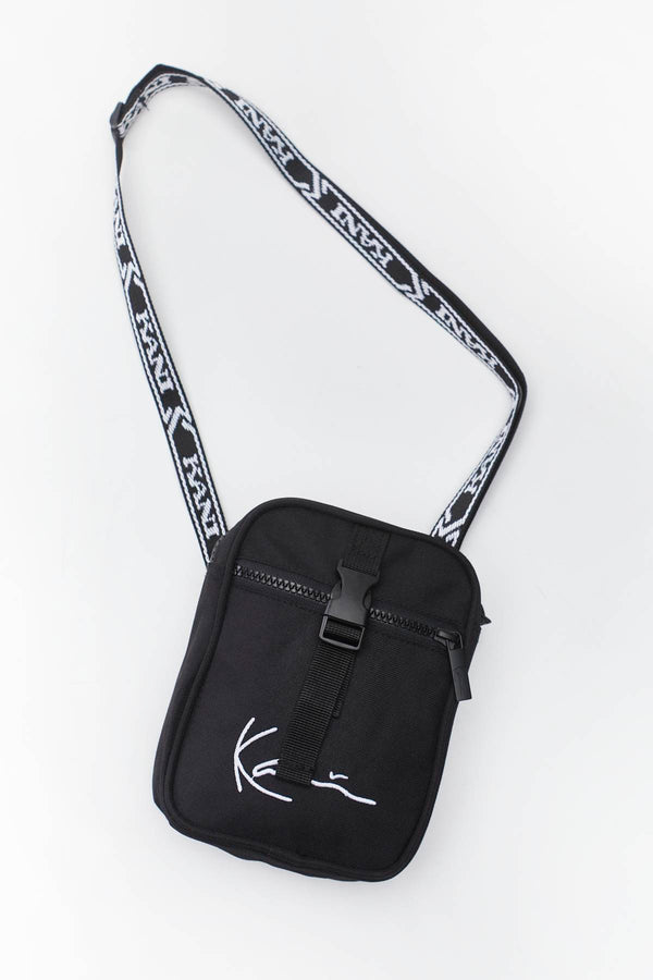 #00058  Karl Kani taštička SIGNATURE TAPE MESSENGER BAG 484 BLACK/WHITE