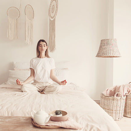 Meditation teacher is meditating in the bed in the morning