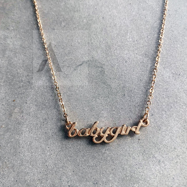 Gold Tone Baby Girl Text Necklace
