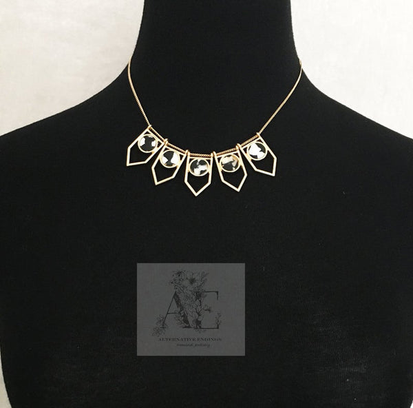Gold Tone Geometric Black and White Resin Necklace