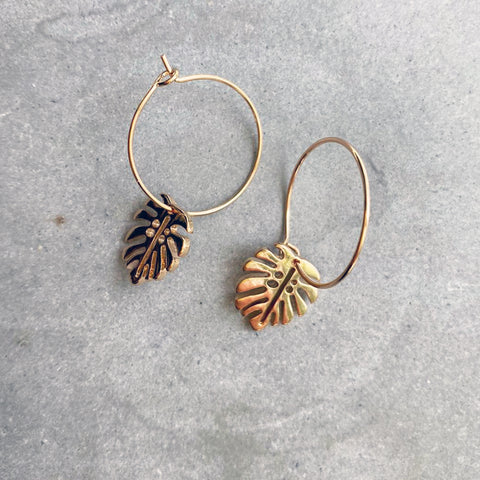 Gold Toned Monstera Leaf with a small Hoop Earrings