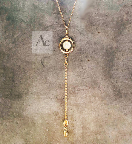 Gold Toned Pearl Lariat necklace with seashell charm