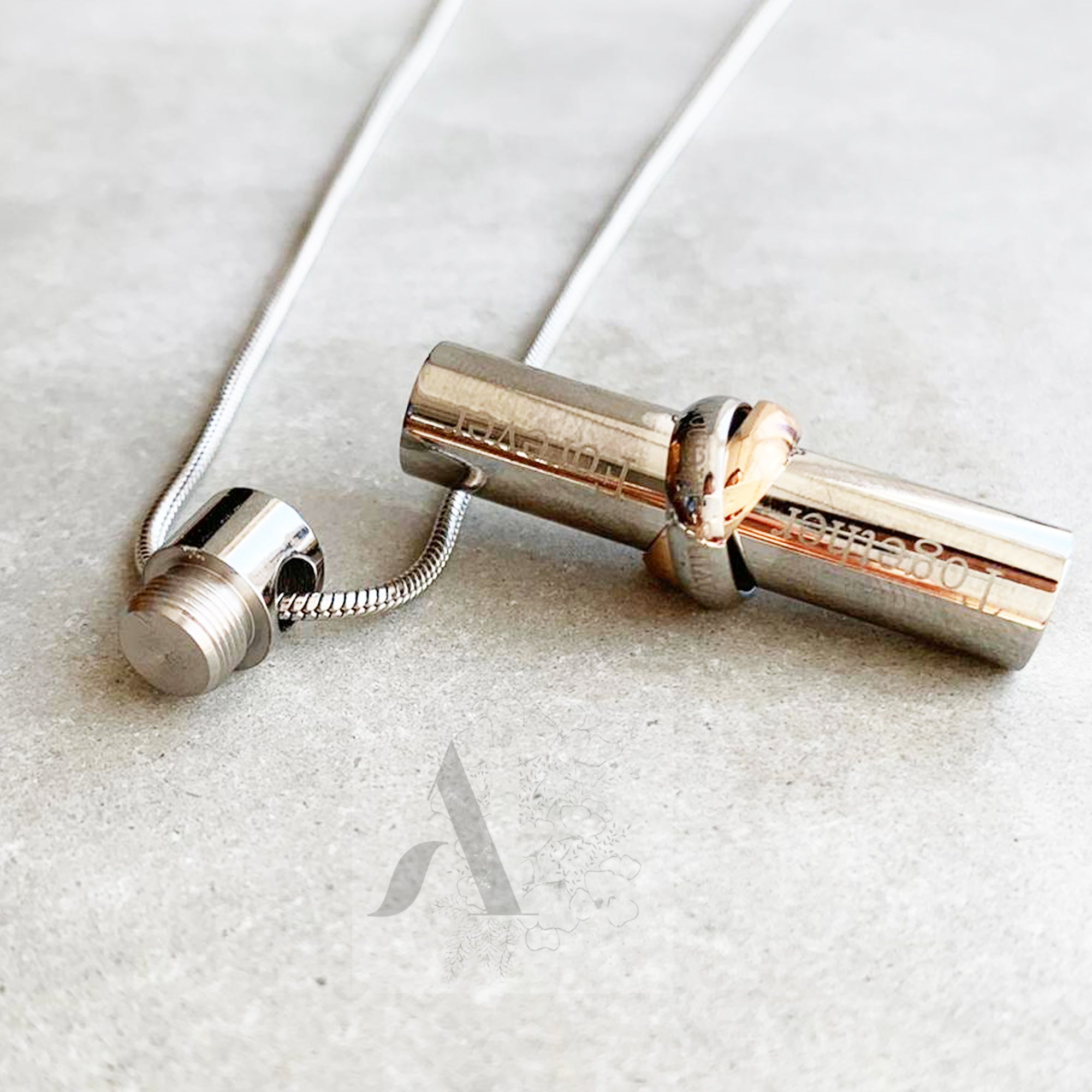 Stainless Steel Cylinder Ash Pendant with a Two Tone Bow Necklace