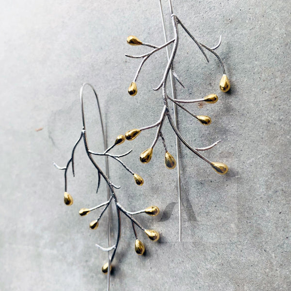 Silver tree branches with gold plated tips earrings by @JewelleryAE