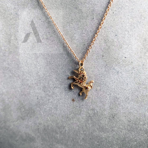 Gold Tone Unicorn Necklace