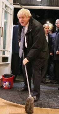 Boris Johnson mopping up floodwater. Sort of.