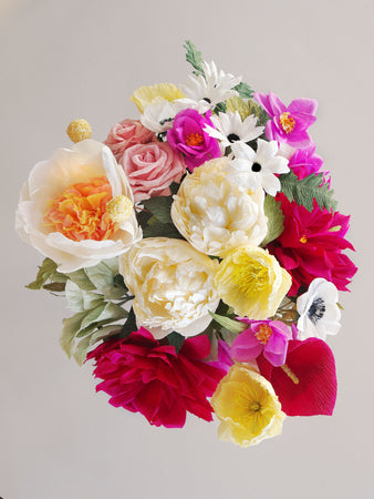 _<h1>Give the Royal Treatment</h1><p>Ivory and cream with dramatic accents of burgundy and purple; 2 varieties of peonies, burgundy dahlias, purple spray roses, white anemone, daisies, cream poppies, burgundy calla lilies, and pale purple roses finished with assorted shades of greenery.</p>