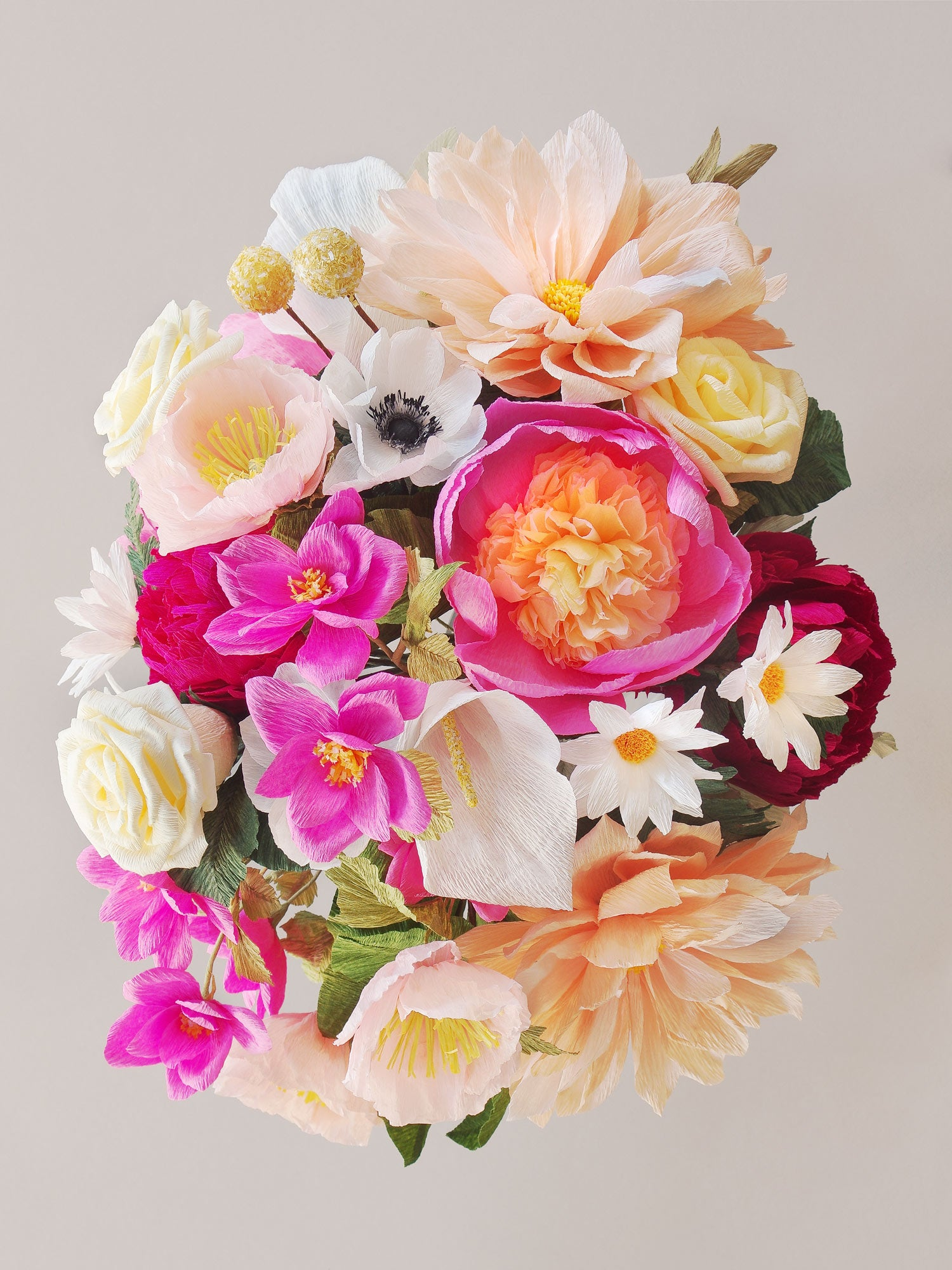 _<h1>Overwhelm Them With Blooms</h1><p> Various hues of pink and peach with hints of ivory and white; 2 varieties of peonies, peach dahlias, pink spray roses, white anemone, white daisies, pale pink poppies, white calla lilies, and cream roses complete with assorted shades of greenery.</p>