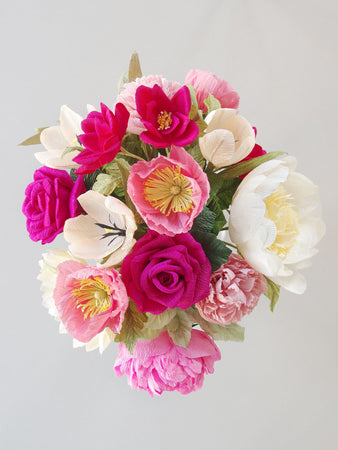_<h1>A Cult Classic</h1><p>Shades of pink and cream; 2 varieties of peonies, hot pink roses, burgundy spray roses, pink carnations, pink poppies, peach tulips, and a pale yellow sunflower finished with assorted shades of greenery.</p>