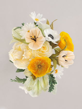 _<h1>Can't Go Wrong</h1><p>Classic cream with pops of yellow; ivory peonies, orange poppies, cream roses, white daisies and white anemone accented  with pale and sage shades of greenery.</p>