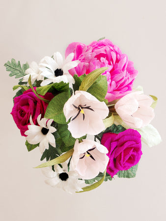 _<h1>Bring The Outdoors In</h1><p>Pink peony, pale pink tulips, white daisies and hot pink roses completed with assorted greenery.</p>