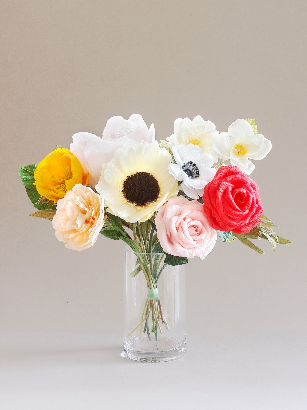 _<h1>When a Mimosa Won't Cut It</h1><p>Peach centered peony, assorted hues of roses, a pale yellow sunflower, a pop of peach carnation and orange poppy finished with assorted greenery.</p>