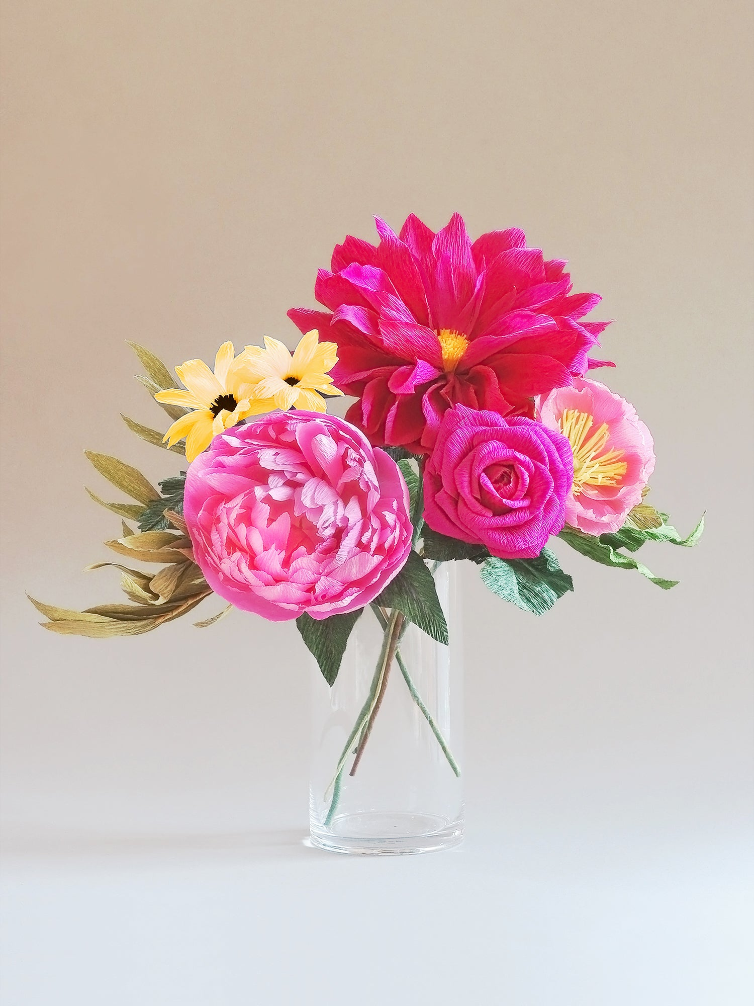 _<h1>Pink Skies Ahead</h1><p>Dramatic burgundy dahlia mixed with a bright pink peony, pale pink icelandic poppy and a hot pink rose.  Bright yellow diaies and mixed stems of greenery complete this bouquet.</p>