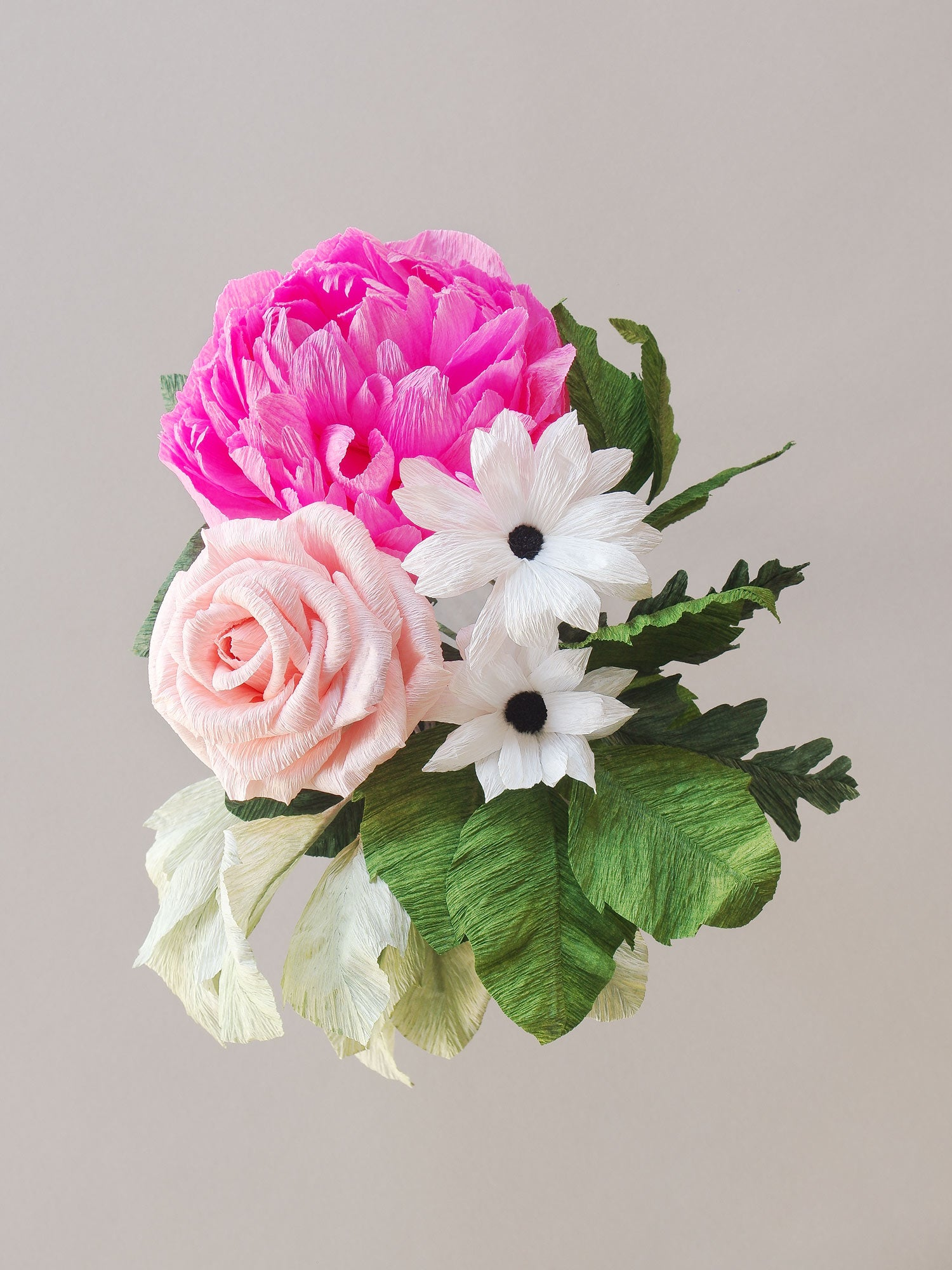 _<h1>Small & Mighty</h1><p>Pink peony, white daisy, and peach rose with a touch of greenery.</p>