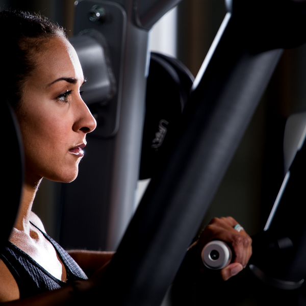 Woman about to start a Precor strength based exercise
