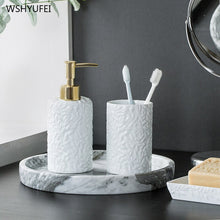 Load image into Gallery viewer, Fine embossed pattern home hotel bathroom supplies simple white ceramic bathroom kit cotton swab box mouth cup soap bottle set