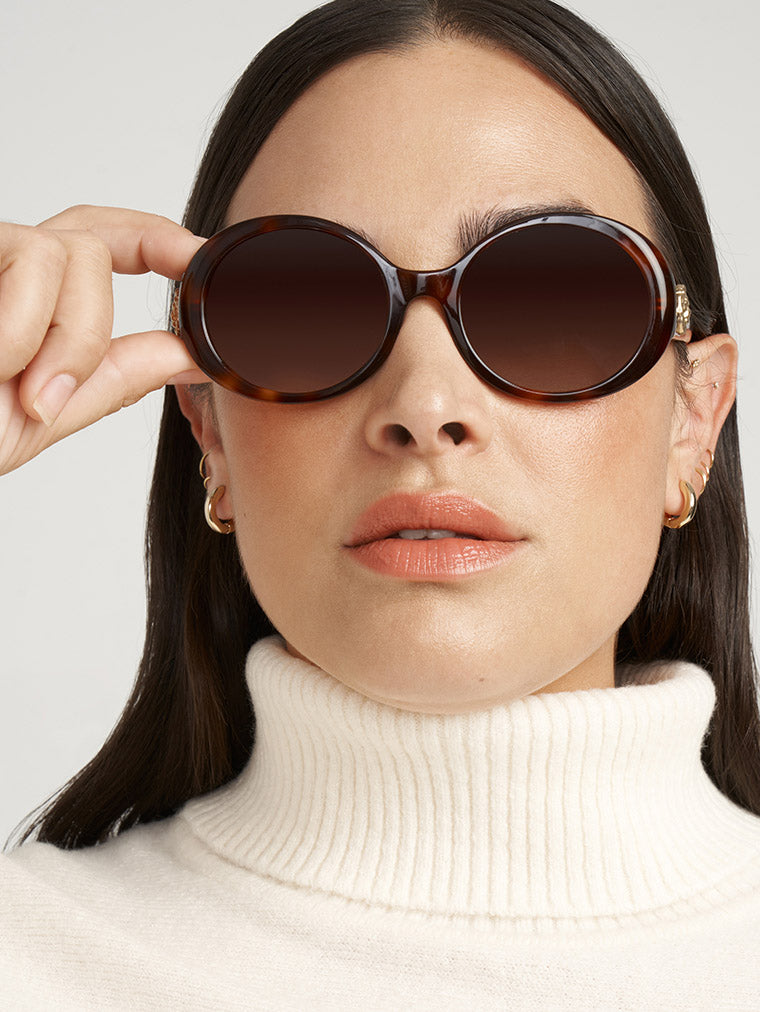 Anne Klein on model round sunglasses