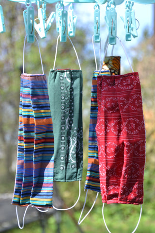 Washable face masks hanging up to dry