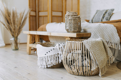 Earthy bedroom decor featuring woven baskets and pampras grass