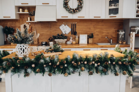 Kitchen decorated with a wreath and greenery for the holidays