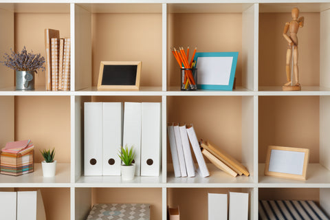 Cubby shelving holding files and decorative pieces
