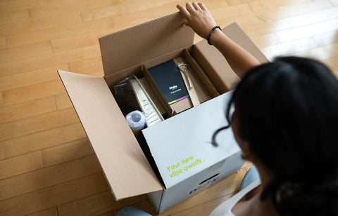 Woman Opening Digby Paints Delivery Box