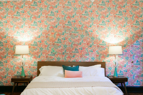 Bedroom with blue and pink floral wallpaper accent wall