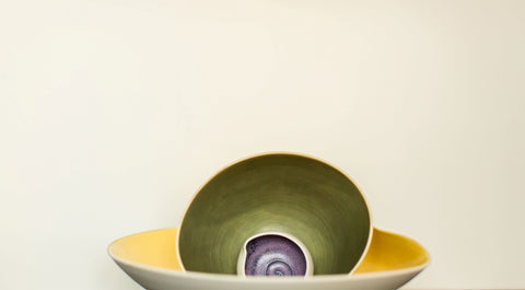 Decorative bowls placed in front of a while painted with Digby Paints premium interior wall paint colour Full Moon Party