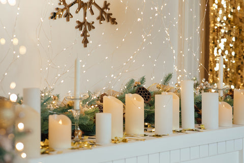 Mantel decorated for the holidays with candles