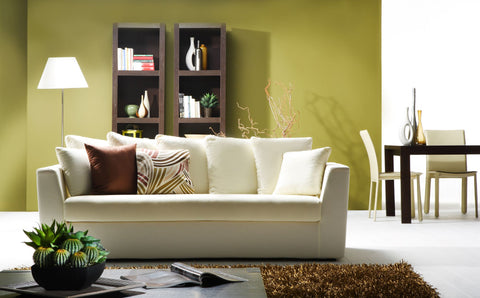 peaceful Matcha coloured living room with cream and dark wood accents