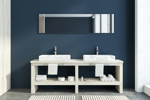 Double bathroom sink with navy accent wall