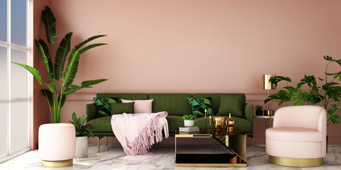 Pink living room with emerald green accents and vibrant plants