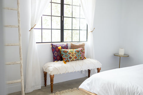 Earthy bedroom design accented by SouthWestern style colourful pillows