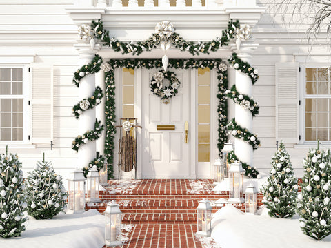 Front porch decorated with green and silver and gold for christmas